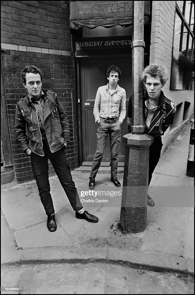 British punk group The Clash in north London, April 1977. Left to right: singer <a gi-track='captionPersonalityLinkClicked' href=/galleries/search?phrase=Joe+Strummer&family=editorial&specificpeople=226957 ng-click='$event.stopPropagation()'>Joe Strummer</a> (1952 - 2002), guitarist <a gi-track='captionPersonalityLinkClicked' href=/galleries/search?phrase=Mick+Jones+-+Musician+-+The+Clash&family=editorial&specificpeople=212985 ng-click='$event.stopPropagation()'>Mick Jones</a> and bassist <a gi-track='captionPersonalityLinkClicked' href=/galleries/search?phrase=Paul+Simonon&family=editorial&specificpeople=216507 ng-click='$event.stopPropagation()'>Paul Simonon</a>.