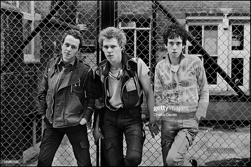 British punk group The Clash in north London, April 1977. Left to right: singer Joe Strummer (1952 - 2002), bassist Paul Simonon and guitarist Mick Jones.