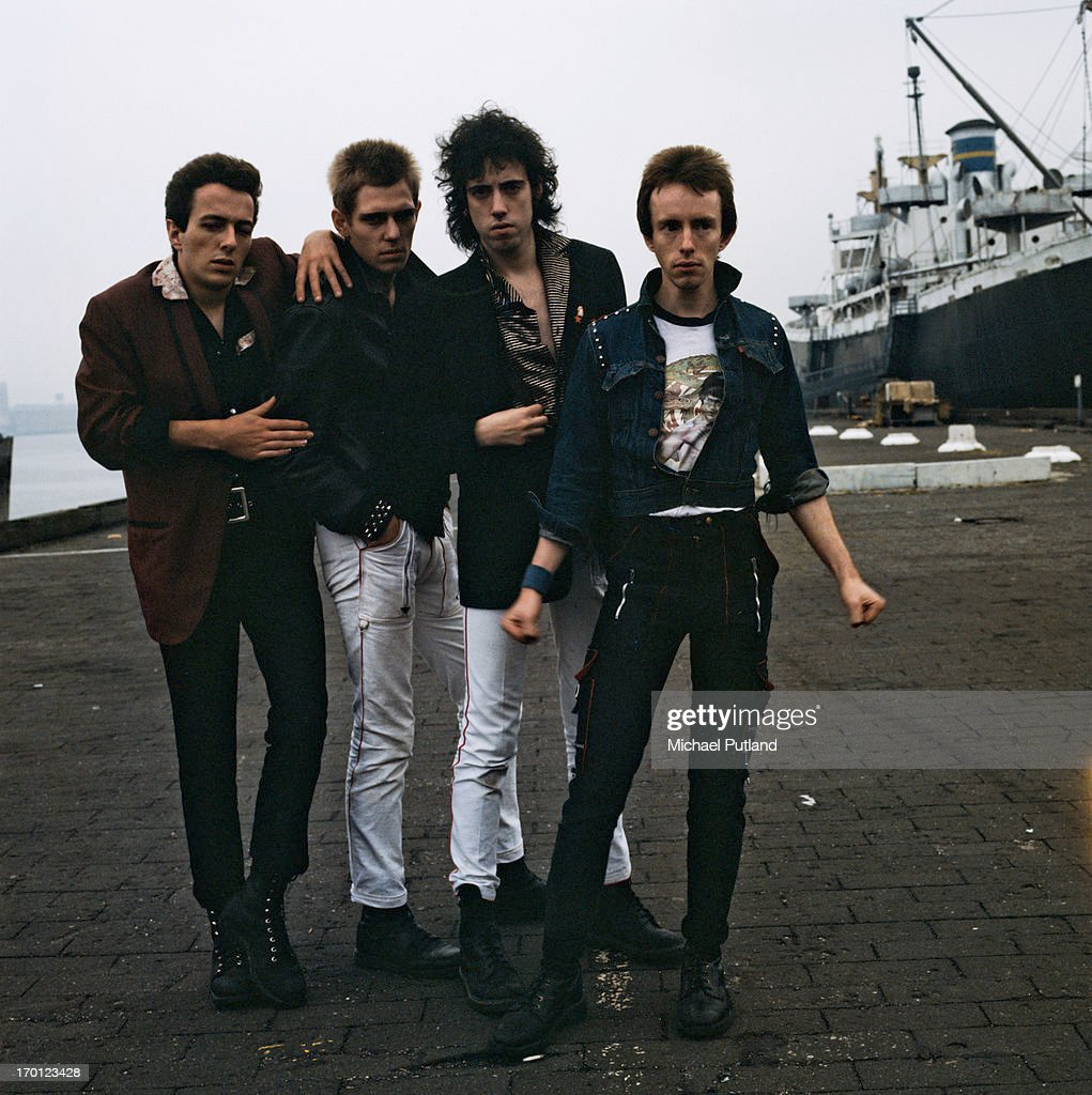 British punk group The Clash on a quayside in New York Harbor, 1978. Left to right: singer <a gi-track='captionPersonalityLinkClicked' href=/galleries/search?phrase=Joe+Strummer&family=editorial&specificpeople=226957 ng-click='$event.stopPropagation()'>Joe Strummer</a> (1952 - 2002), bassist <a gi-track='captionPersonalityLinkClicked' href=/galleries/search?phrase=Paul+Simonon&family=editorial&specificpeople=216507 ng-click='$event.stopPropagation()'>Paul Simonon</a>, guitarist <a gi-track='captionPersonalityLinkClicked' href=/galleries/search?phrase=Mick+Jones+-+Musician+-+The+Clash&family=editorial&specificpeople=212985 ng-click='$event.stopPropagation()'>Mick Jones</a> and drummer Nicky 'Topper' Headon.