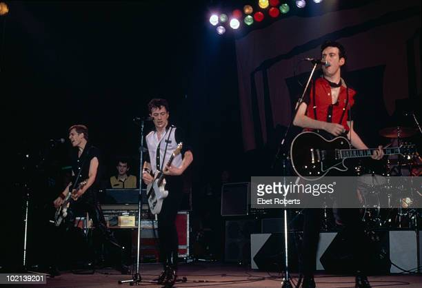 British punk group The Clash performing on stage 1980 Standing left to right Paul Simonon Joe Strummer and Mick Jones