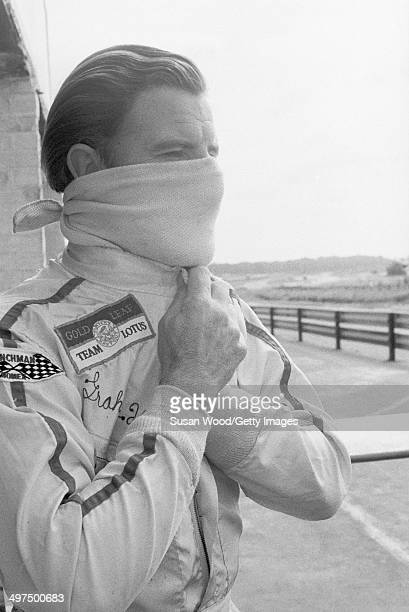 British racecar driver and team owner Graham Hill puts on a scarf before a race England January 1970