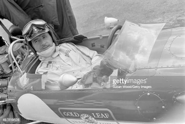 British racecar driver and team owner Graham Hill sits behind the wheel of his Formula One car England January 1970