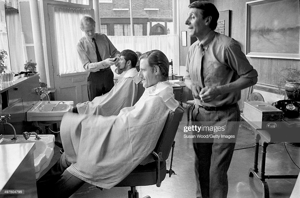 Barber Embassy : ... 1929 - 1975) sits in a barbers chair, London, England, January 1970