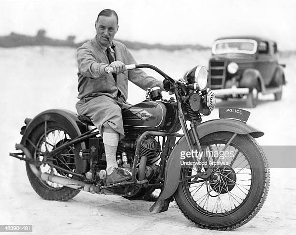 British racer Captain Malcolm Campbell tries out a policeman's Harley Davidson but he won't get near the 300 mph he hopes to reach in his Bluebird...