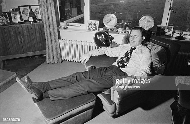 British racing driver and team owner Graham Hill relaxing at home 5th January 1972