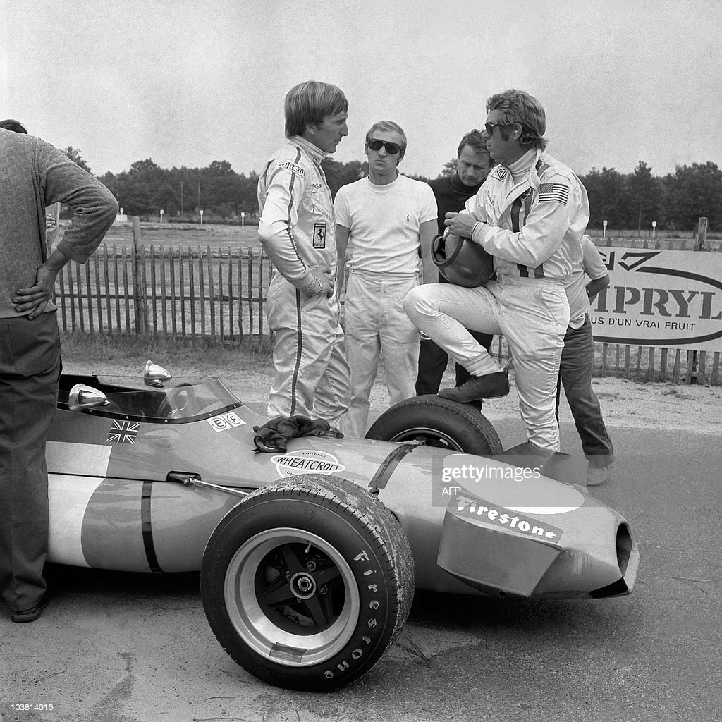 British racing driver Derek Bell and US actor Steve McQueen are pictured during the filming of 'Le Mans' directed by Lee HKatzin on August 20 1970 in...