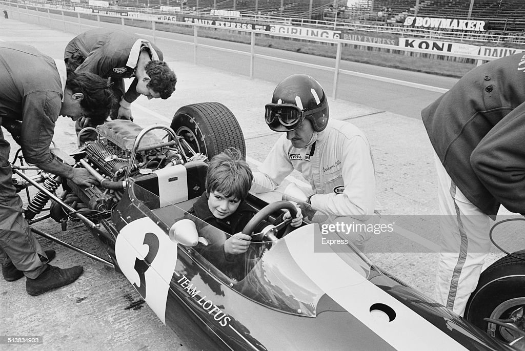 British racing driver <a gi-track='captionPersonalityLinkClicked' href=/galleries/search?phrase=Graham+Hill&family=editorial&specificpeople=94550 ng-click='$event.stopPropagation()'>Graham Hill</a> (1929 - 1975) overseeing his son Damon in the driving seat at the Silverstone Circuit, 27th April 1967.