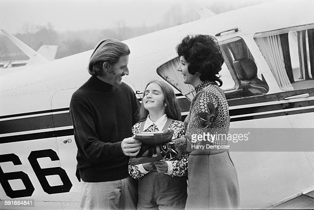 British racing driver Graham Hill standing by his Piper PA23350 Aztec light aircraft at Elstree Airfield Hertfordshire with his wife Bette and their...