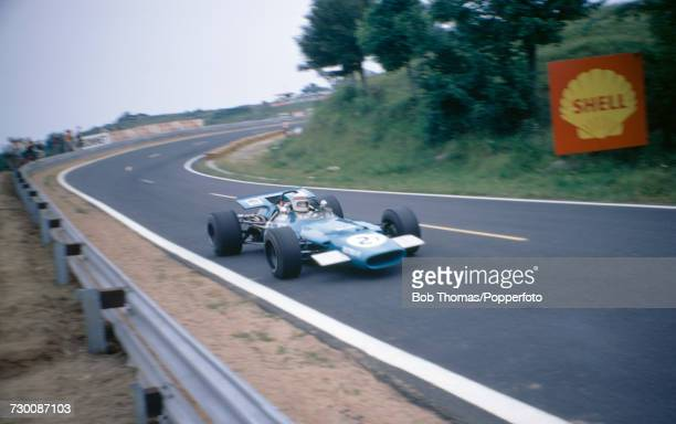British racing driver Jackie Stewart drives the Matra International Matra MS80 Ford Cosworth DFV in practice prior to competing to finish in first...