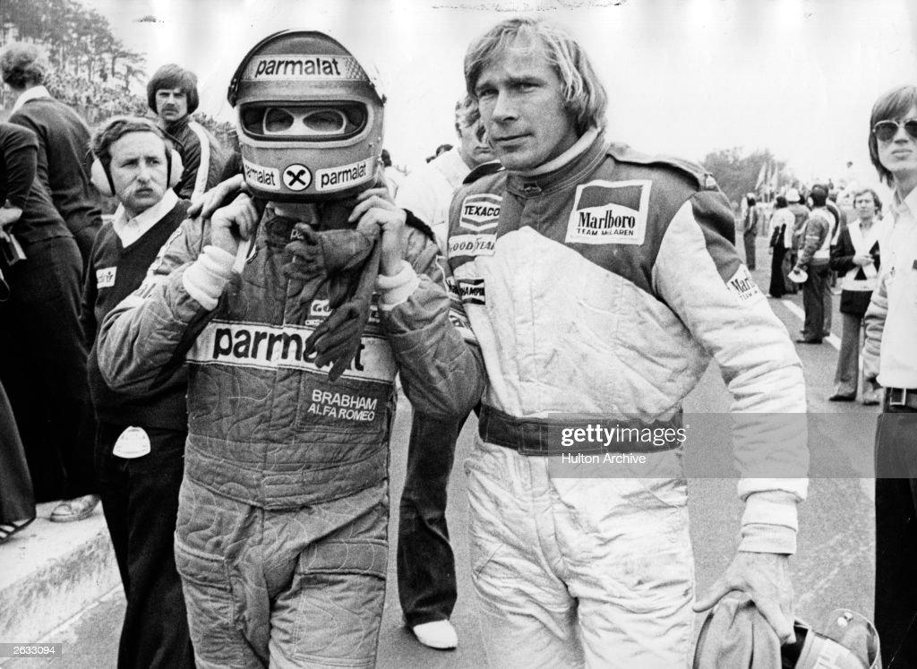 British racing driver James Hunt (1947 - 1993) and Austrian <a gi-track='captionPersonalityLinkClicked' href=/galleries/search?phrase=Niki+Lauda&family=editorial&specificpeople=218060 ng-click='$event.stopPropagation()'>Niki Lauda</a> abandoning the race after they have crashed into each other. Original Publication: People Disc - HG013