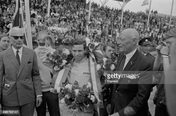 British racing driver Jim Clark celebrating his win after a Grand Prix 1964