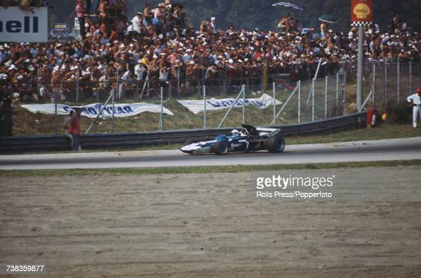 British racing driver John Surtees drives the Brooke Bond Oxo Team Surtees Surtees TS9 Ford Cosworth DFV 30 V8 in the 1971 Italian Grand Prix at...