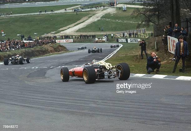 British racing driver John Surtees in the Ferrari during the Belgian Grand Prix at the SpaFrancorchamps circuit 12th June 1966