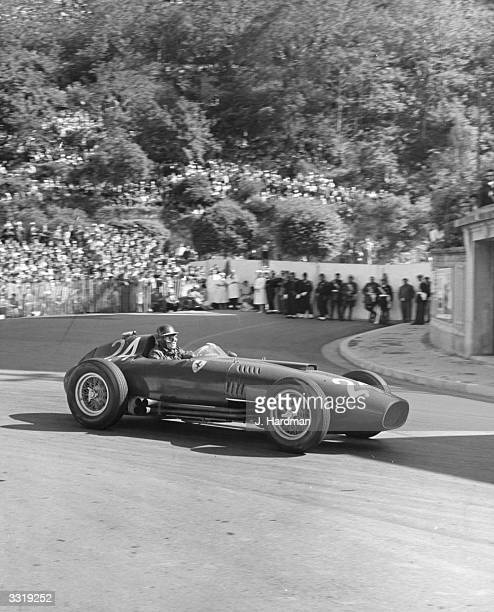 British racing driver Mike Hawthorn at speed at Gasmeter Hairpin during the 1957 Monaco Grand Prix driving a Ferrari