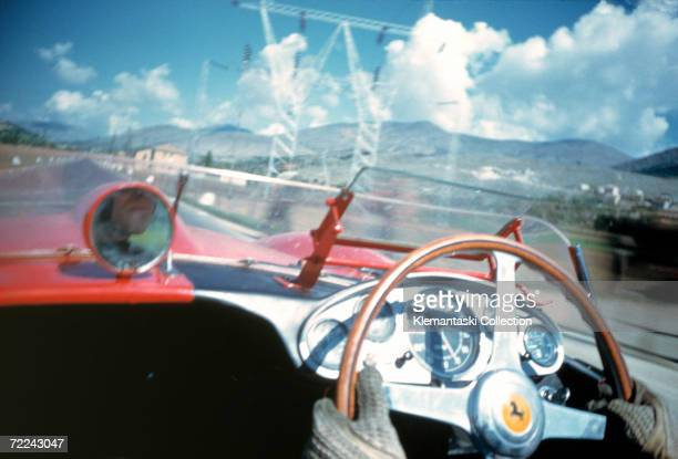 British racing driver Peter Collins competing for Ferrari in the Mille Miglia along the Adriatic coast May 1957 the last year the race was run in its...