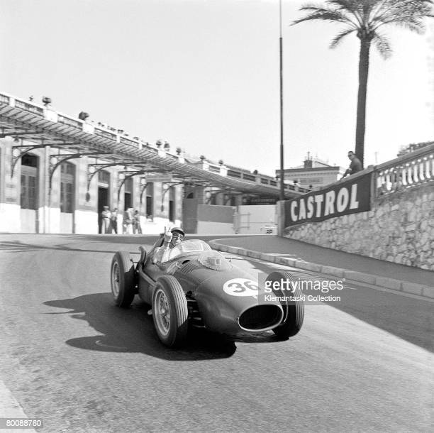 British racing driver Peter Collins gestures to photographers from his Ferrari at the old Station Hairpin during the Monaco Grand Prix Monte Carlo...