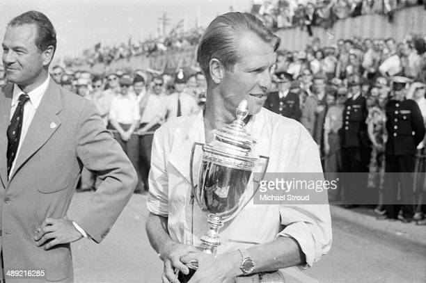 British racing driver Peter Collins receiving his winners trophy at the British Grand Prix Silverstone July 19th 1958 Peter Collins would be killed...