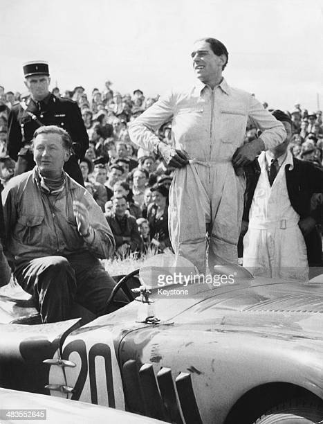 British racing drivers Peter Whitehead and codriver Peter Walker with their Jaguar CType car after winning the 24 Hours of Le Mans France 23rd June...