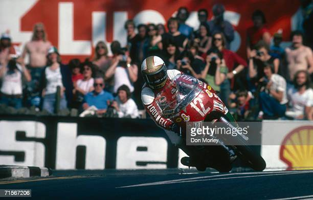 British racing motorcyclist Mike Hailwood riding a Ducati on his way to victory in the Formula One race at the Isle of Man TT races June 1978
