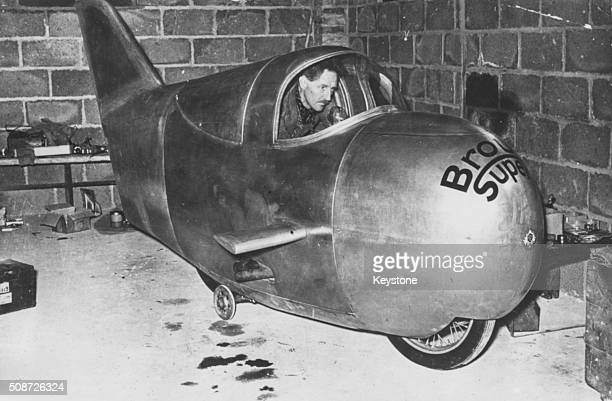 British racing motorcyclist Noel Pope sitting at the controls of a 'flying egg' Brough Superior machine in which he is hoping to break the world...