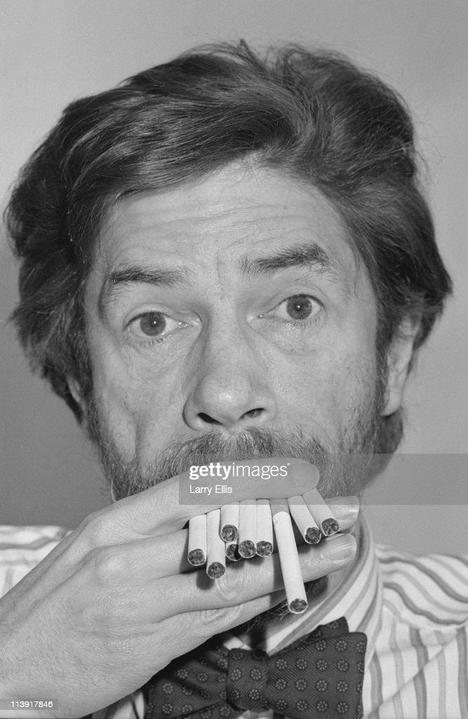 British radio presenter Adrian Love (1944-1999) smoking multiple cigarettes, 23rd March 1989.