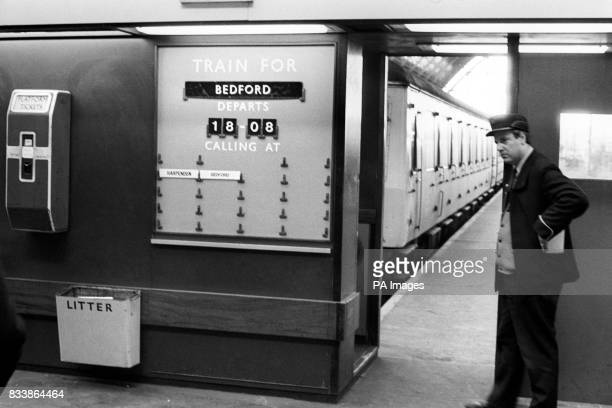 A British Rail ticket clipper waits for passengers for the last train to Bedford from StPancras at 1808