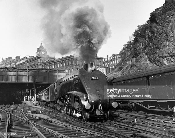 British Railways A4 class 462 steam locomotive No 60014 with a passenger train bound for London Photograph by Eric Treacy