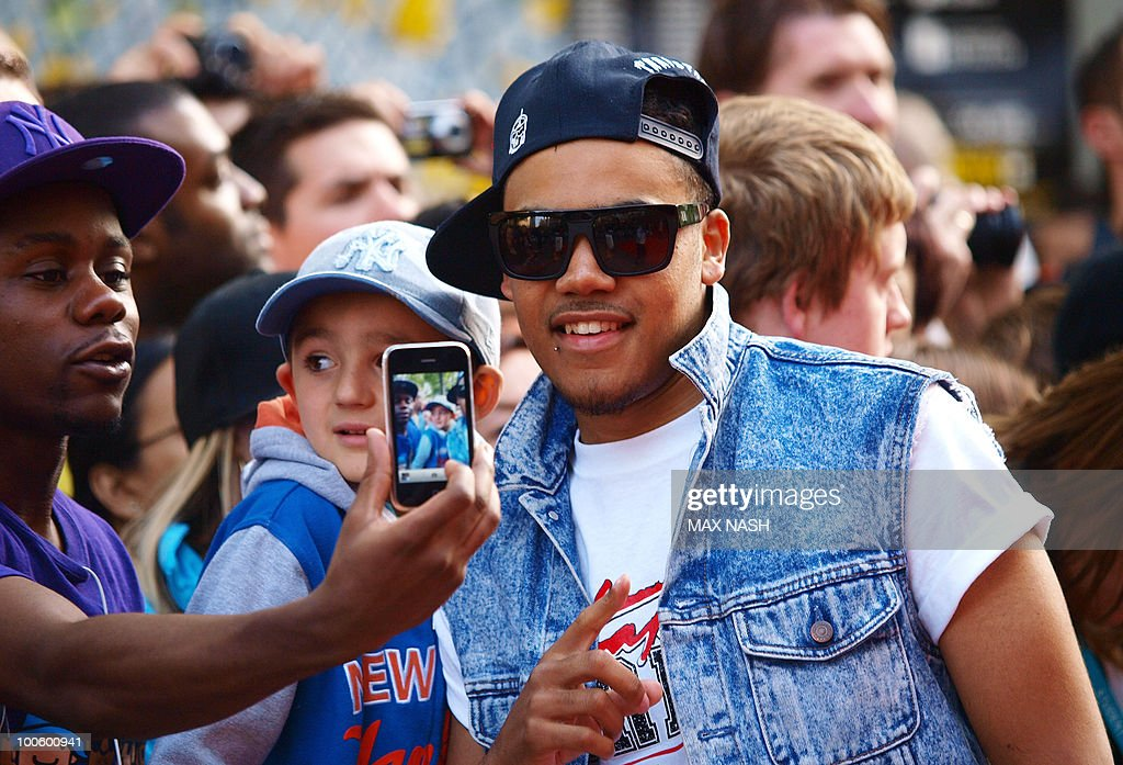 British rapper Master Shorty poses with his fans as he arrives at the World Premiere of the film, '4.3.2.1' in London's Leicester Square on May 25, 2010. AFP Photo/MAX