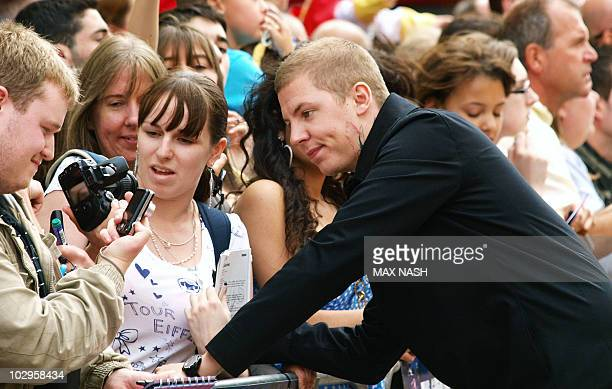 British rapper Professor Green waits for fans to sort their camera out as he arrives in London's Leicester Square on July 18 2010 for the British...