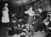 British Red Cross staff examine patients sheltering in Piccadilly underground station during World War II January 1941