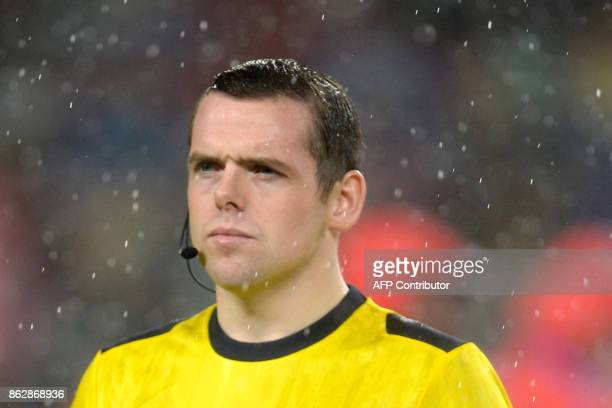 British referee Douglas Ross looks on during the UEFA Champions League group D football match FC Barcelona vs Olympiacos FC at the Camp Nou stadium...