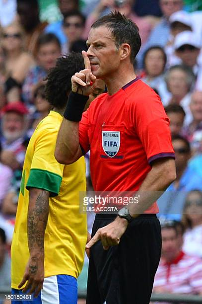 British referee Mark Clattenburg officiates during the men's football final match between Brazil and Mexico at Wembley stadium in London during the...