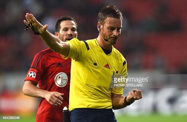 British referee Mark Clattenburg reacts during the UEFA Champions League playoff second leg football match Bayer Leverkusen FC Copenhagen on August...