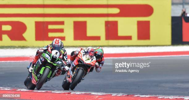 British Rider Jonathan Rea of Kawasaki Racing Team competes with British rider Chaz Davies of Aruba racing for Ducati during the race 1 of 2017 FIM...
