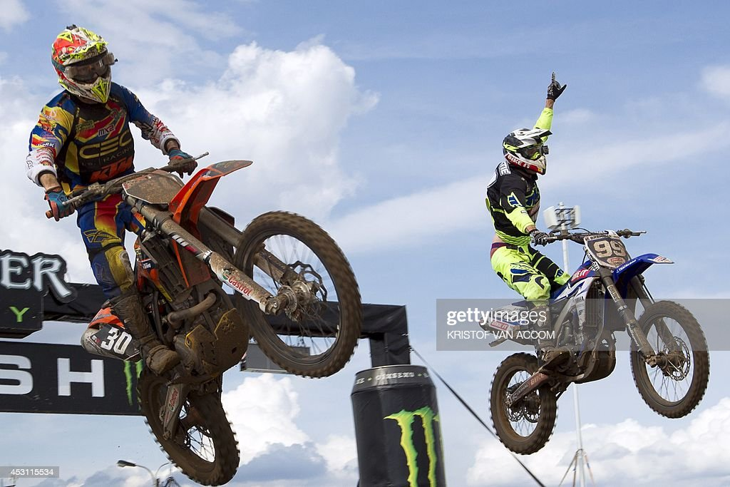 British rider Max Anstie (R) celebrates as he crosses the finish line to win the motocross MX2 Belgian Grand Prix, on August 3, 2014, in Lommel.