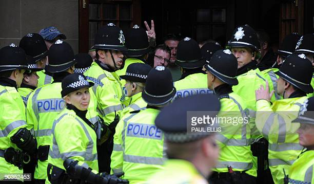 British riot police attempt to control clashes between members of the English Defence League and antifascists in Birmingham central England on...