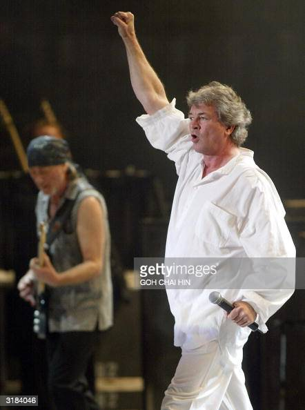 British rock band Deep Purple's singer Ian Gillan performs with guitarist Roger Glover during a concert at the Workers' gymnasium in Beijing 31 March...