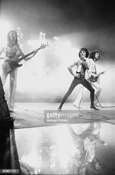 British rock band Queen performing on stage at Madison Square Garden New York City 1977 Left to right John Deacon Freddie Mercury and Brian May