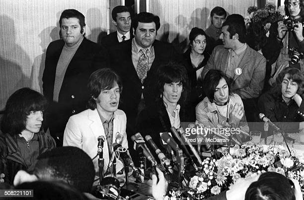 British rock band the Rolling Stones sit behind a bank of microphones during a press conference New York New York November 27 1969 Pictured are...