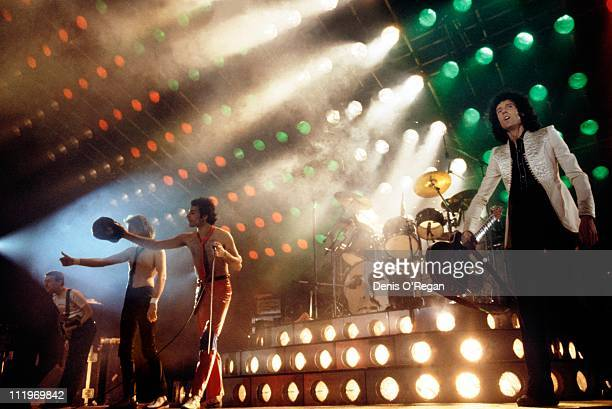 British rock group Queen at the end of a show 1979 Left to right John Deacon Roger Taylor Freddie Mercury and Brian May