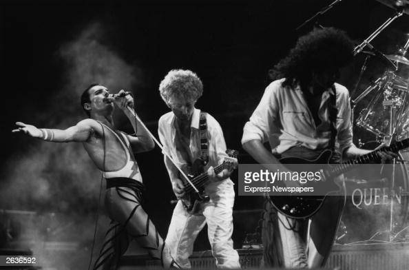 British rock group Queen in concert from left to right Freddie Mercury John Deacon and Brian May Original Publication People Disc HU0463