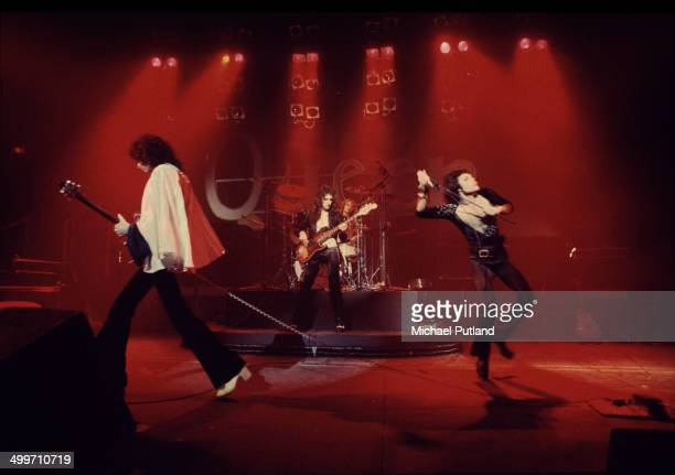 British rock group Queen perform on stage in London 1974 LR Guitarist Brian May bassist John Deacon drummer Roger Taylor and singer Freddie Mercury