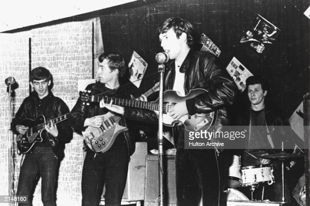 British rock group The Beatles perform in a club prior to signing their first recording contract Liverpool England 1962 LR George Harrison John...