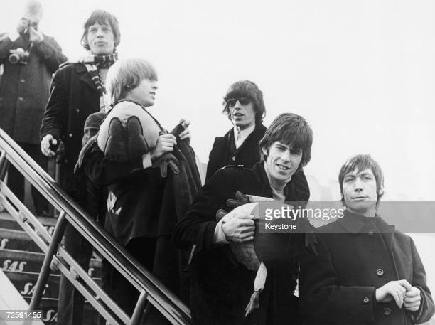 British rock group the Rolling Stones arriving at Copenhagen for a six date tour of Denmark 26th March 1965