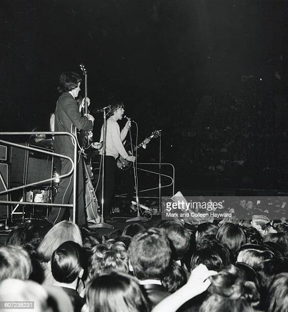 British rock group the Rolling Stones perform onstage at Ready Steady Go's Mod Ball London England April 9 1964