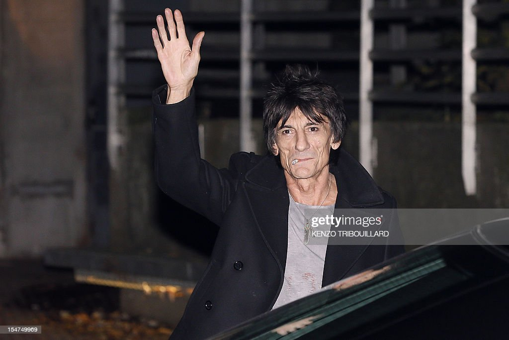 British rock legend and guitarist of The Rolling Stones, Ron Wood waves on October 25, 2012 upon his arrival to the Trabendo concert venue in Paris. The Rolling Stones were due to play a surprise mini-gig in Paris on October 25 and all 350 tickets priced at 15 euros ($20) each were snapped up in minutes.