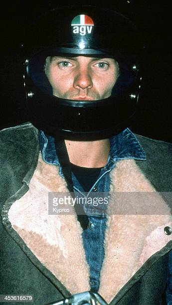 British rock musician and singer Sting wearing an AGV motorcycle helmet Hollywood California circa 1990