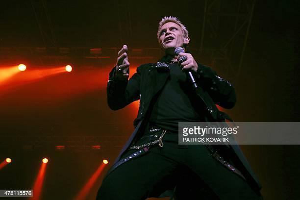 British rock singer Billy Idol performs on stage at the Zenith concert hall on June 22 2015 in Paris AFP PHOTO / PATRICK KOVARIK