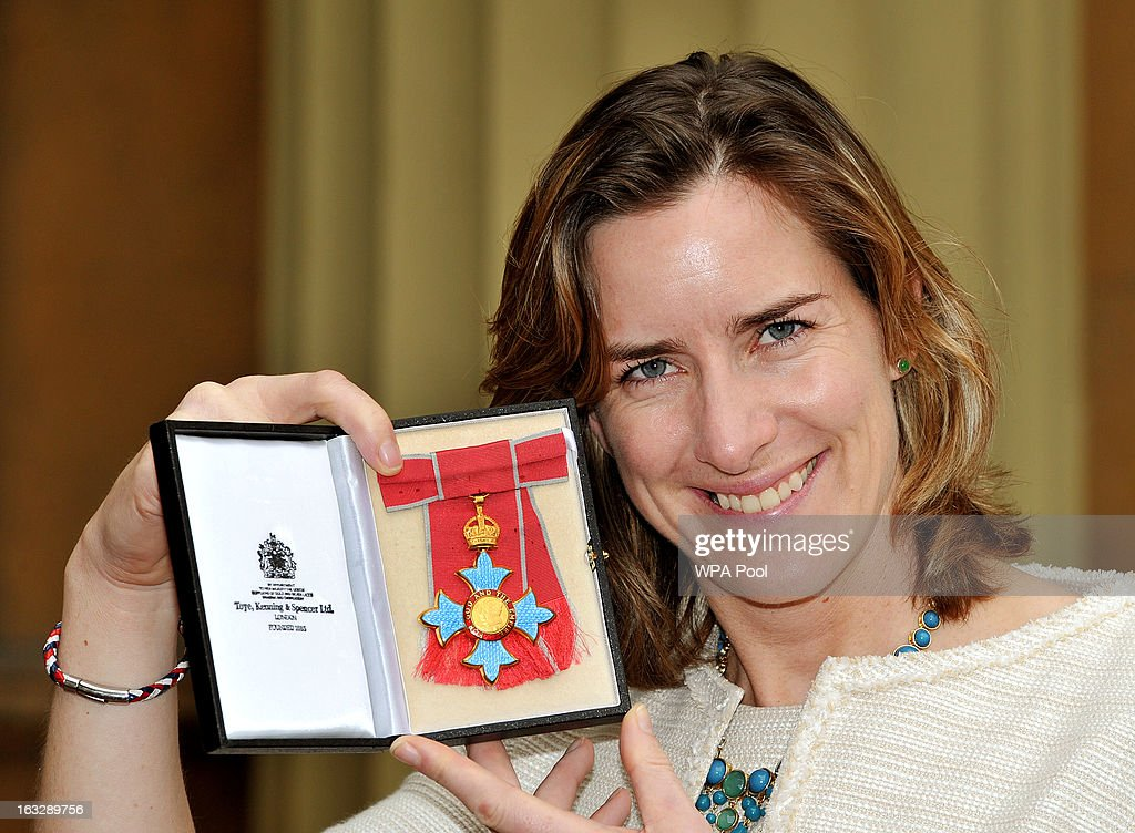 British rower and a 2012 Olympic gold medalist <a gi-track='captionPersonalityLinkClicked' href=/galleries/search?phrase=Katherine+Grainger&family=editorial&specificpeople=240295 ng-click='$event.stopPropagation()'>Katherine Grainger</a> proudly holds her CBE award after the Investiture Ceremony at Buckingham Palace on March 07, 2013 in London, England.