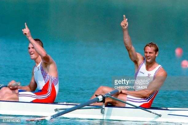 British rowers Matthew Pinsent and Steven Redgrave celebrate after they won the Olympic gold medal in the men's coxless pairs event during the...